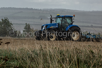 Cultivating in the rain with New Holland tractor