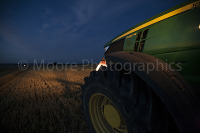 John Deere tractor lighting the field